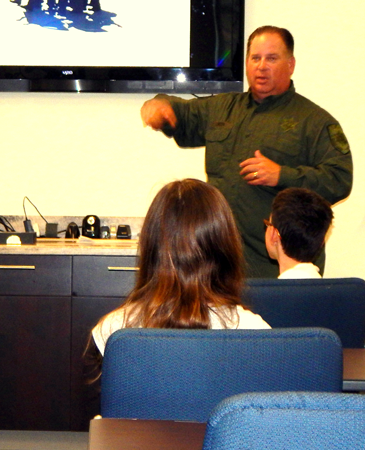 Lt. Robert Norton, commander of the Sheriff's Office SWAT team talks to the Junior Deputy Academy about the responsibilities of the SWAT team.