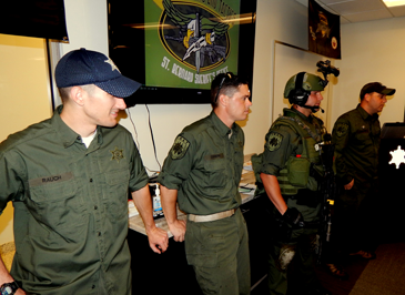 Some of the members of the SWAT team answer questions from the academy participants.