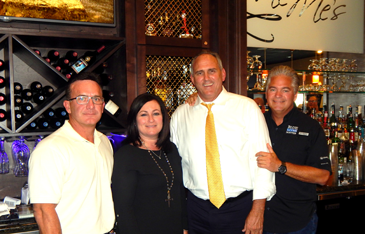 Guest bartenders, from left, District Perry Nicosia, Assessor Jaylynn Bergeron Turner, Parish President Guy McInnis and Sheriff James Pohlmann at the fundraiser to donate equipment for sheriff's deputies.