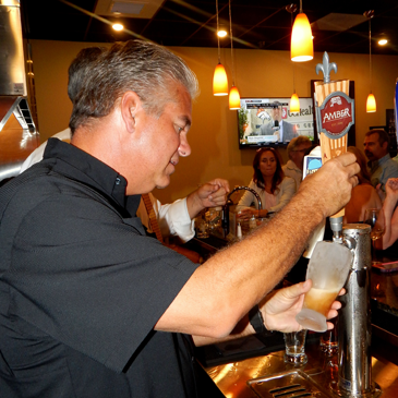 Sheriff James Pohlmann draws a beer for a customer.