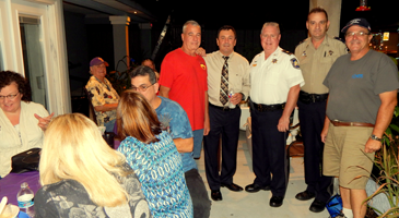 Officials from the Heart of Chalmette Neighborhood Association with sheriff's deputies at a party held for Night Out Against Crime in 2015.