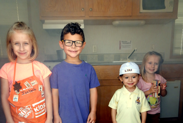 Isabella Held, Noah Wagner, Jonah Wagner and Layla Held inside the parish Fire Department's smoke house, used to teach children how to escape a fire by going to the ground to avoid smoke inhalation before leaving a building.