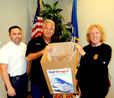 From left, Agent Jason Saltalmachia, Sheriff James Pohlmann and Capt. Pat Childress with one of the boxes of medications disposed of by the public at the Drug Take-Back event.