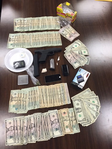 Gun, cocaine, heroin,  cash and drug paraphernalia seized.
