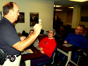 Capt. Charles Borchers demonstrates to a class items he recommends in the Refuse to be a Victim lecture given by the Sheriff's Office. Register for the next free class, being held at 6:30 p.m. on Dec. 7, by calling (504) 278-7628 or (504) 278-7799.